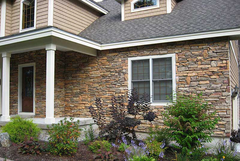 Before- Stone color on this vacation home contained more rust colors than the owners desired.