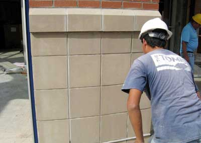 After-Cast Stone is color corrected to match surrounding panels, even with expected imperfections copied.  A mason stops to examine the work up close, because it looks and feels exactly the same from unstained to stained.