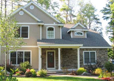 After- the rust colors were carefully balanced back with cool to neutral taupes and tans, making the home blend with the lovely, natural surroundings at Lake George, NY
