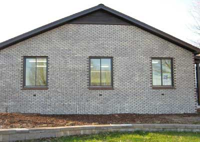 After-the brick addition is an exact match to the original brick, down to the basket weave pattern around windows and doors.
