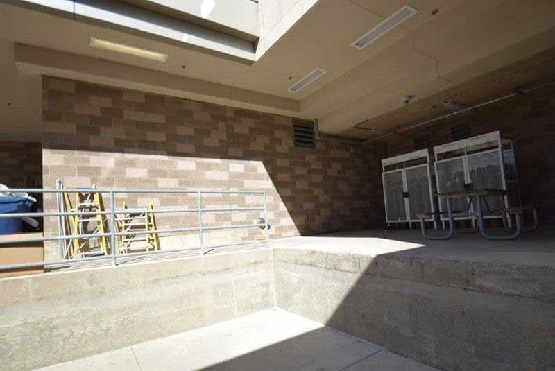 After, dark gray limestone panels were stained a light, natural sand buff to blend with surrounding limestone panels.