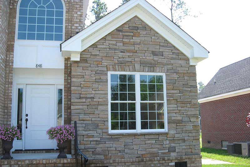 After- gray color is added back to the upper section which was too orange. Now the stone coordinates with the homeowner's brick color as originally planned.
