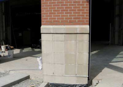 Before- Cast Stone color varies on some of the panels, causing concern for the owner.