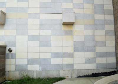 Before, dark gray limestone panels create a checker board effect.