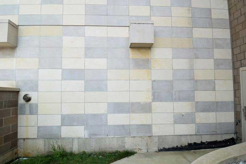 Before, dark gray limestone panels create a checker board effect.