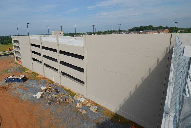 Staining PreCast Stone Parking Garage Project
