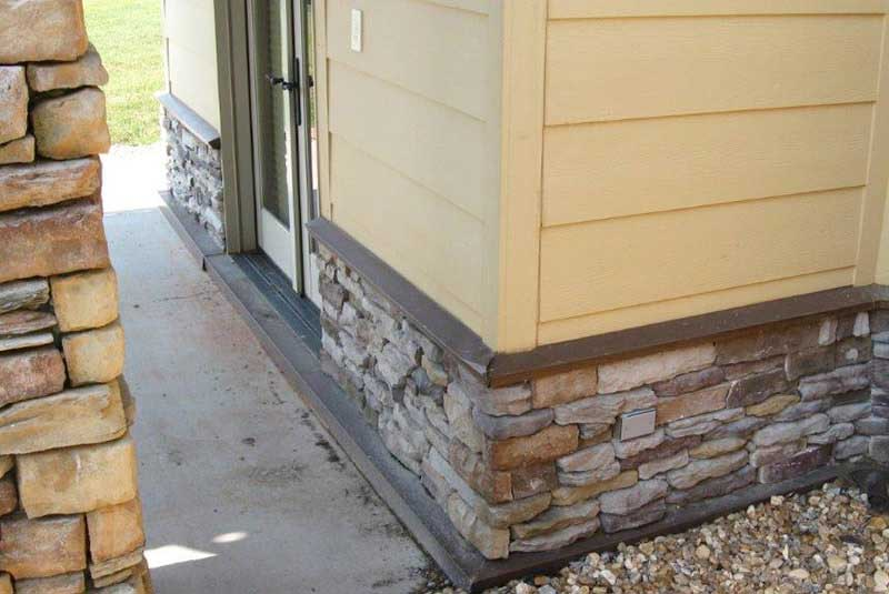 During- stone is corrected (left), and awaiting our color repair (right) after pressure wash damage