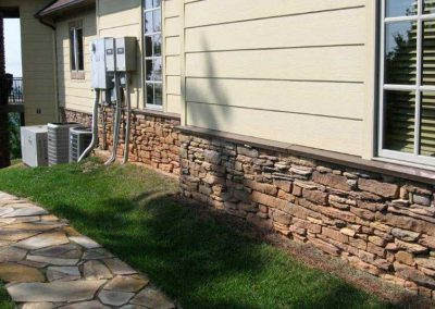 During- stone color is restored(right) and red clay damaged stone is still apparent (left).