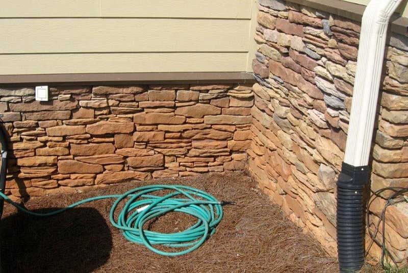 Before- stone color shows clay soil damage which can't be safely removed without damaging stone color.