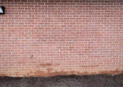 After- graffiti damaged brick is matched back to correct color range.