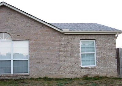 Before- the addition was built in a uniform color brick in a matching texture.