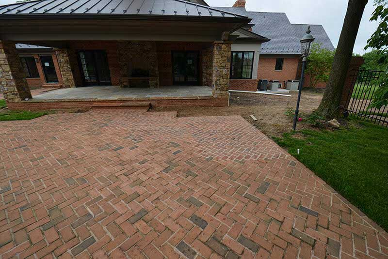 Before- mortar is light between brick pavers and must be darkened