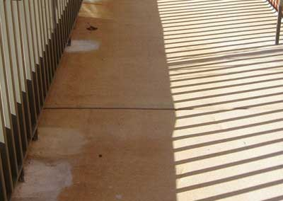 Before-this walkway and a concrete pad inside the Spotsylvania building needed to be stained to match.