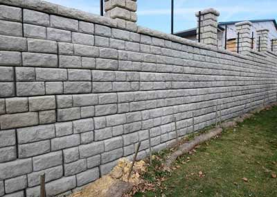 Cobblestone pattern retaining wall install is complete, prepped and ready for custom color