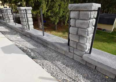 After: Custom charcoal gray color with darker charcoal accents complete the high-end, natural stone look