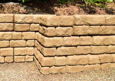 After- Redi-Rock Cobblestone in one, custom color to complete the look of the wall