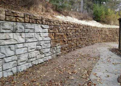 During Plain Concrete Transforms to Standard Redi-Rock Ledgestone Color Sorrel Canyon Rose Brown Colors