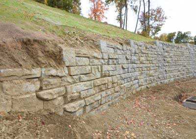 1-Before-Plain-Concrete-Is-Incomplete-Soiled-Redi-Rock-Discolors-Over-Time