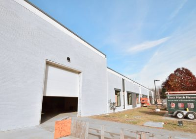 A Company's Headquarters Gets A Masonry Staining Makeover in Light Gray